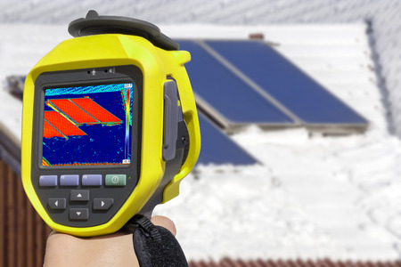 thermal image: Recording Photovoltaic Solar Panels on the roof House With Thermal Camera