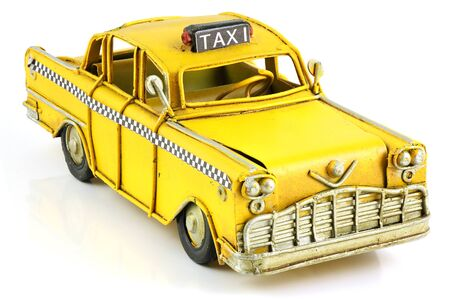 limo: Old retro toy yellow taxi isolated on white background