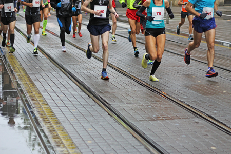 Unfocused Marathon running race in city streets