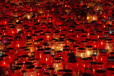 votive: A lot of Candles Burning At a Cemetery During All Saints Day
