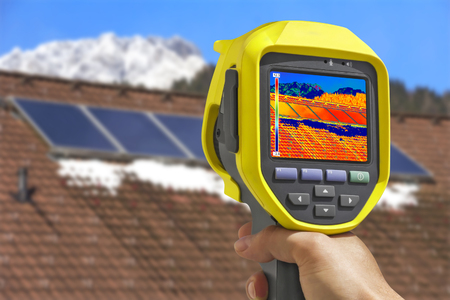 solar panel roof: Recording Photovoltaic Solar Panels on the roof House With Thermal Camera