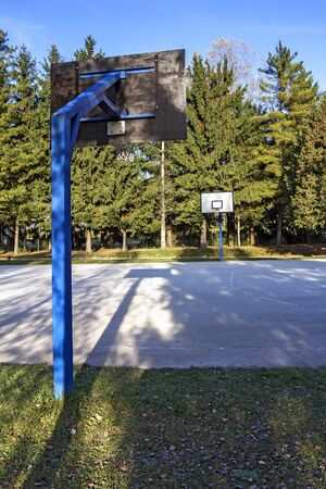 schoolyard: Outdoor schoolyard basketball concrete court, no players