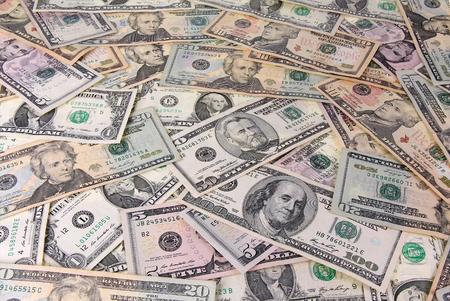 dollaro: Pila di banconote di dollari come sfondo