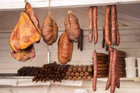 fat food: Smoked Sausage and Bacon Preserved Pork Meat  in a street market Stock Photo