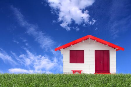 tecnology: Wooden prefabricated house on the grass and the blue sky in the background Stock Photo