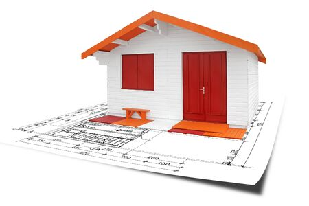 prefabricated buildings: Wooden assembly House with blueprints, isolated on white background