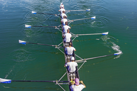 sculling: Boat coxed eight Rowers training rowing on the lake