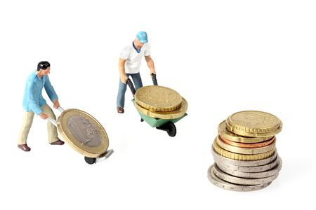 Two Miniature workers drives euro coins in wheelbarrow