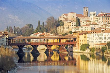 Famous old wooden bridge Ponte Vecchio in village Bassano del Grappa, Italy