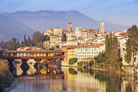 vechio: Famous old wooden bridge Ponte Vecchio in village Bassano del Grappa, Italy