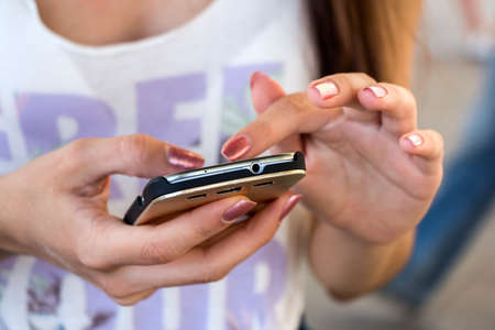 mobile sms: Young girl used smartphone or cell phone