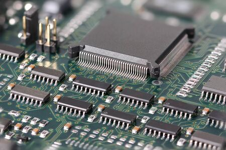 microprocessor: Green Circuit board with microprocessor and other electronic components