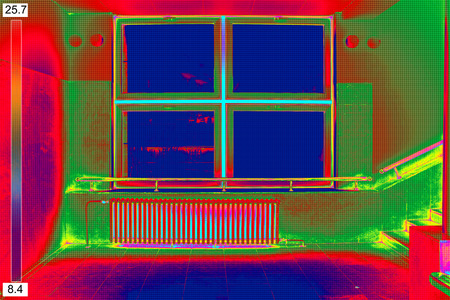 warmness: Infrared Thermal Image of Radiator Heater and a window on a building