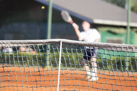 tennis net: Tennis net, Man plays tennis, blurred motion