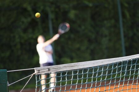 racket stadium: Tennis net, Man plays tennis, blurred motion