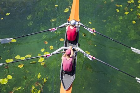 muscle fiber: Two rowers in a boat, rowing on the tranquil lake