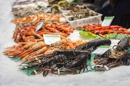 Lobsters, shrimps and prawns, fresh seafood in the fish market in Barcelona