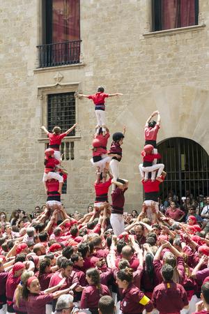 fiesta popular: BARCELONA, SPAIN - JUNE 26, 2016: Castellers group of people that build human castles on June 26, 2016 in Barcelona.  Castles is a Human Tower traditional festivities in Catalonia Spain.
