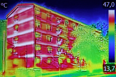 thermogram: Infrared thermovision image showing lack of thermal insulation on Residential building