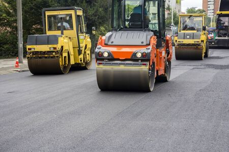 roller compactor: Compactor roller during road construction at asphalting work