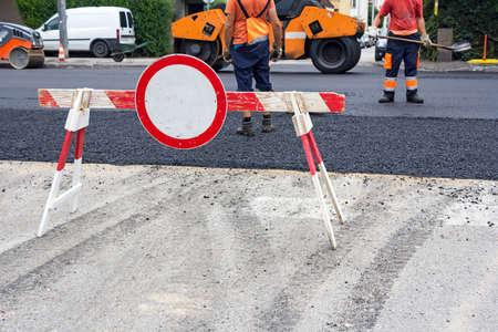 Workers on Asphalting road during repairing works