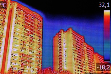 thermal image: Infrared thermovision image showing lack of thermal insulation on Residential building
