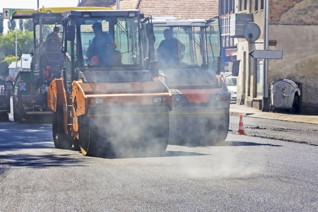 vibroroller: Roller compactor working on the new road construction site
