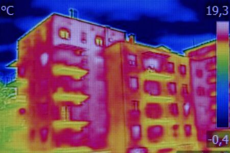 thermography: Infrared thermovision image showing lack of thermal insulation on Residential building
