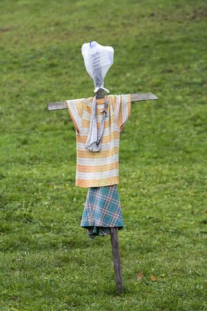 Scarecrow made of old clothes in a field