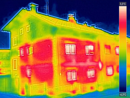 Infrared thermovision image showing lack of thermal insulation on House with or without facade Stockfoto