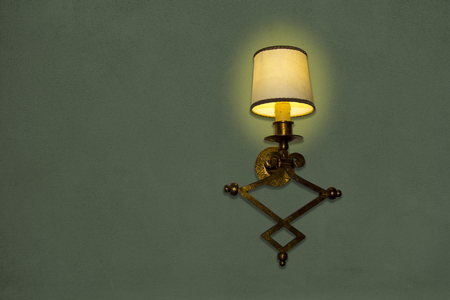 Old wall lamp made of metal with shade from canvas