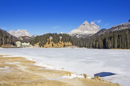 lake misurina: Panoramic views of the frozen lake Misurina and Tre Cime di Lavaredo in Background