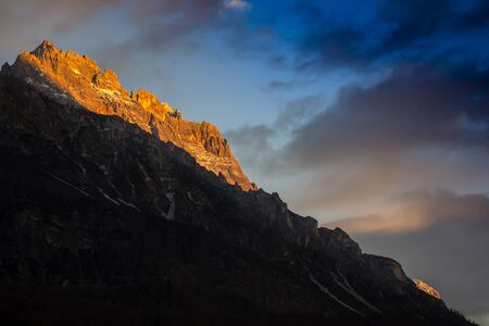 shaddow: Sunset in Dolomites, mountains around Famous ski resort Cortina D Ampezzo Stock Photo
