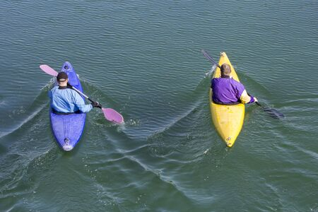 recreate: Two rowers with canoe recreate in a lake Stock Photo
