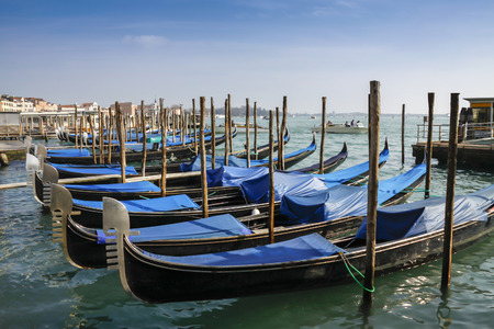 Gondolas moored in front of Saint Mark square in Venice, Italy  Stock Photo