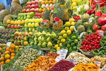 Many various fruit and vegetables at a market stall in Barcelona