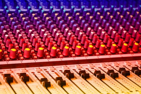 Sound mixing console with colorful backlit buttons