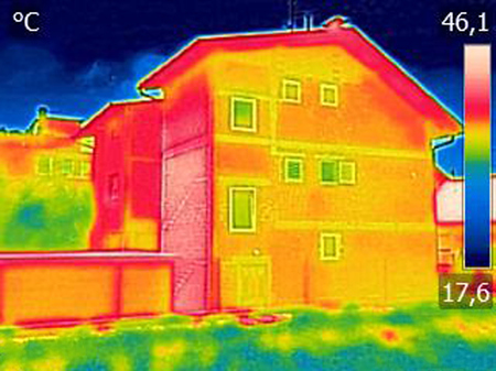 Infrared thermovision image showing lack of thermal insulation on House with or without facade Stock Photo
