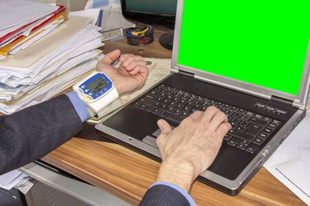 stockholder: Businessman with high blood pressure due to stress caused by the decline in investment on green screen