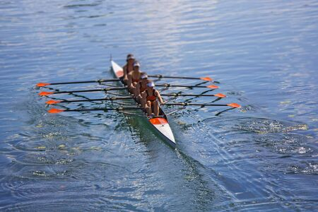 Team of rowing Four-oar women in boat