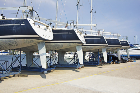 Luxury yachts at shipyard waiting for maintenance and repair