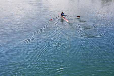 Single scull rowing competitor, rowing race one rower Stock Photo