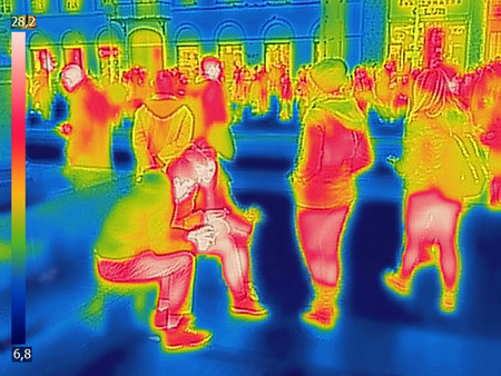 Infrared Thermal image of people at the city railway station, on a cold winter day Stock Photo