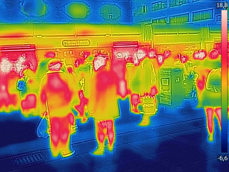 Infrared Thermal image of people at the city railway station, on a cold winter day Stok Fotoğraf