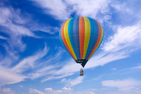 Colorful hot-air balloon flying in the blue sky