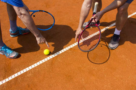 Tennis players shows the track on the tennis court