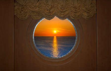 Beautiful Sunset Seen Through a round Ship Porthole