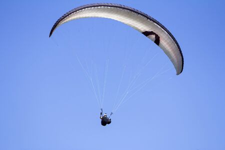 Paragliding in the blue sky as background extreme sport