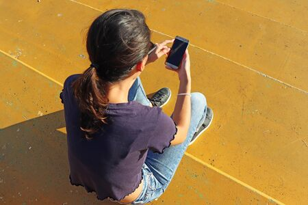 Young girl watching smart mobile phon