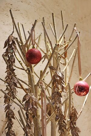 Two red christmas balls on a golden twigs as decoration Stockfoto